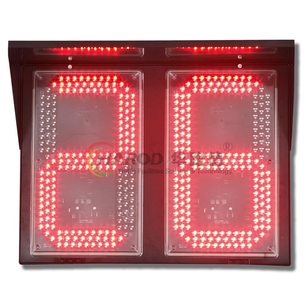 华路德生产的系列信号灯倒计时器采用高性能单片机控制,通过跟踪最多达六路信号灯灯色信号,计算每一个灯色组合的持续时间,通过高亮度LED发光管显示出来,给机动车驾驶员最醒目的提示。 产品特点 外壳材料采用铝型材和铝板,经过毛坯加工、去毛刺、喷塑等多道工序,重量轻,外形美观大方,永不生锈。 笔划段采用专门模具外框+封胶处理,防水性能好,直接贴于面板表面,避免了采用透明面板方式容易积尘等缺陷。 发光材料采用亮度高、光衰减率低的四元素LED发光管(已生产的产品中最长正常使用年限已超过10年) 该系列倒计时器接线